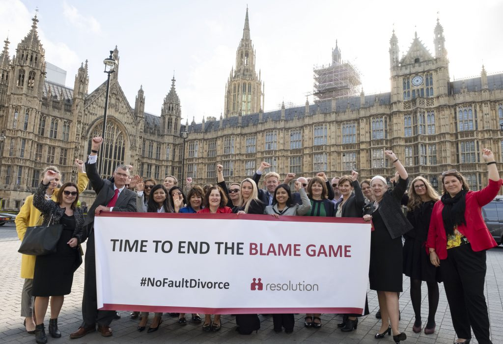 Resolution members outside Parliament calling for government to end the blame game