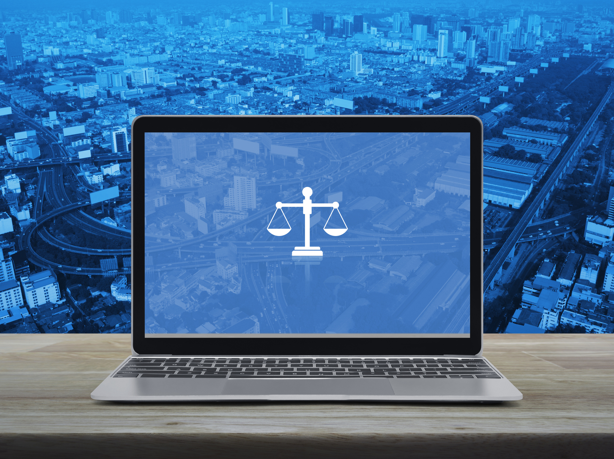Law flat icon with modern laptop computer on wooden table over city tower, street, expressway and skyscraper, Business legal service online concept