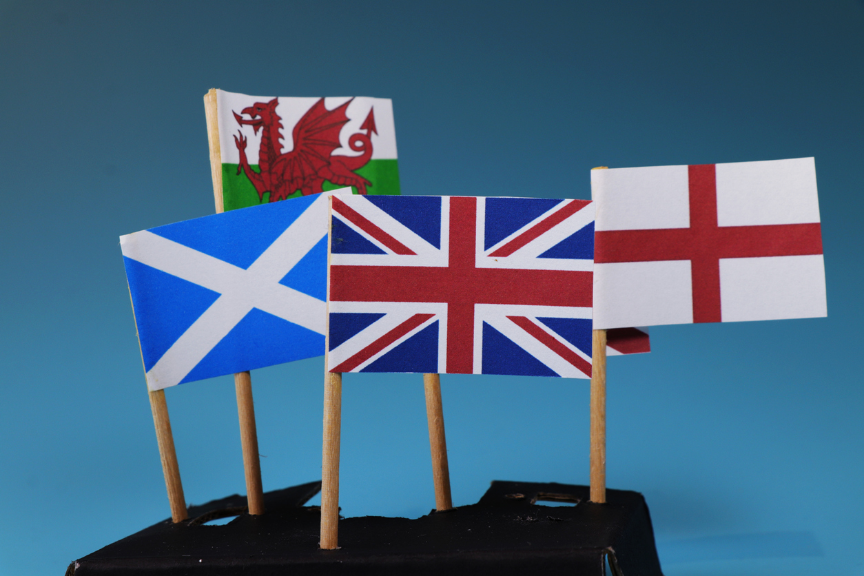 A United kingdom flag and their members as Scotland, England, Nothern Ireland, Wales. Blue background